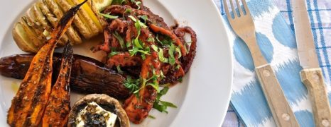 Octopus in red wine with fan potatoes